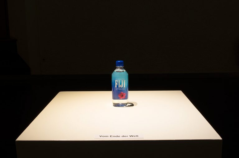 Bottle of Fiji Water (mineral water) on a plinth